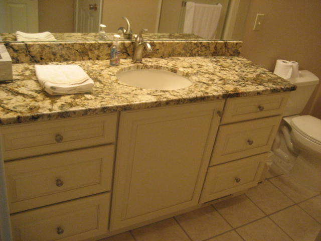 NEW CABINETS, TOPS, FAUCET, MIRROR, AND TOILET